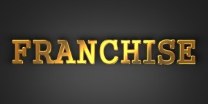 Franchise - Business Concept. Golden Text on a Black Background.